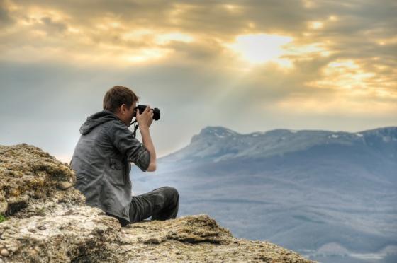 Photographer on rock